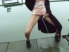 Full bladder diva in a dress pisses on pier