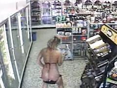 Bikini girl pisses on floor of convenience store