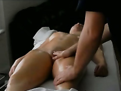 Oil massage with arousing stimulation of her clitoris