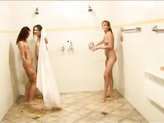 Three teen girlfriends soap up in the shower