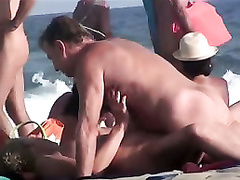 Swinger lady swallows penis in beach compilation