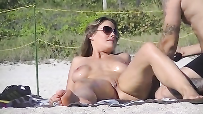 Big-breasted chick gets oiled up