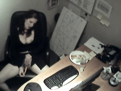 Busty business woman fucks a carrot at work