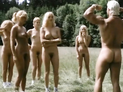 Nudist girls work out in a grassy field