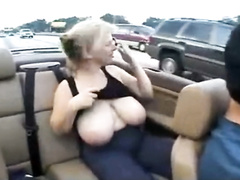 Blonde mommy flashes her huge breasts on the highway