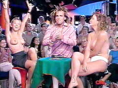 Ladies strip naked on a TV show for the audience