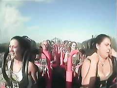 Big tits pop out on roller coaster cam