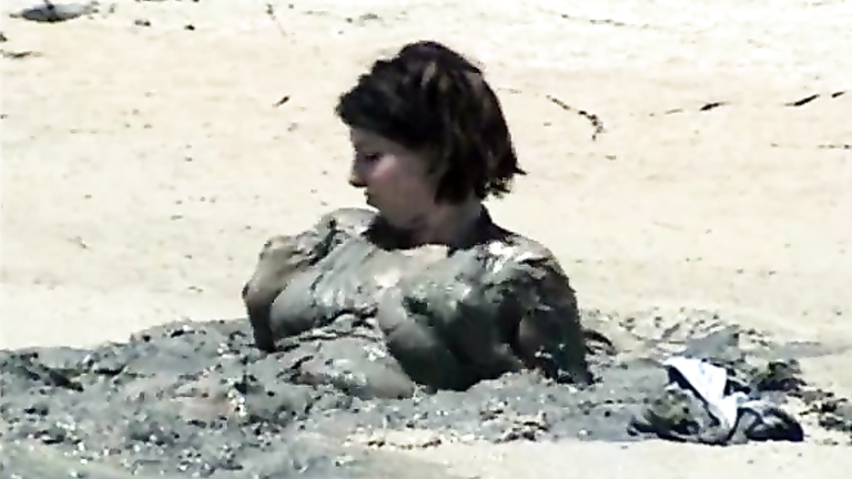 Naked girl in mud can