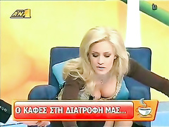 Big tits downblouse of blonde TV host