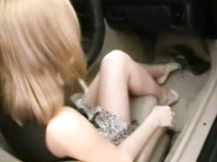 Charming lassie in black dress rides gear shift in the car