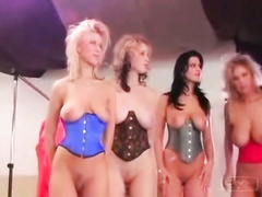 Large-breasted models flash underbust corsets at the naughty fashion show