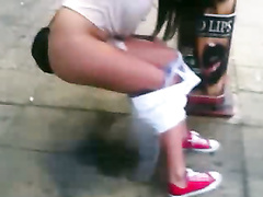 Wasted chick takes a piss on a public sidewalk