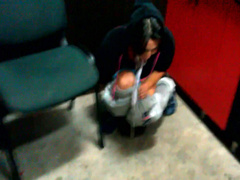 Girl pees into a cup in the office