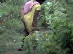 Indian women pissing in the grass in voyeur video