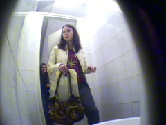 Spy cameras in restroom film girl pissing