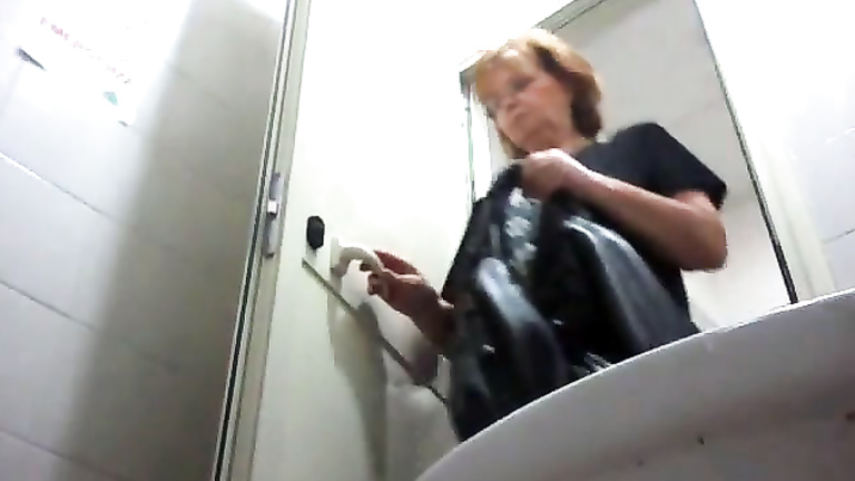 Mature woman poops and wipes in toilet camera video