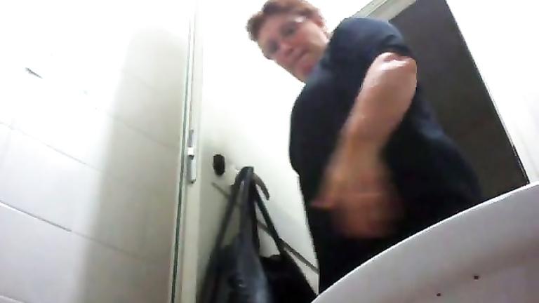 Mature mom urinates with the toilet door wide open