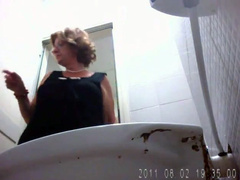Chubby amateur mommy pisses in public toilet