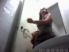 College girl in glasses voids urine in spycam porn