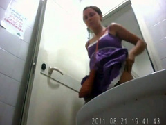 Amateur girl in a purple dress caught pooping in public toilet