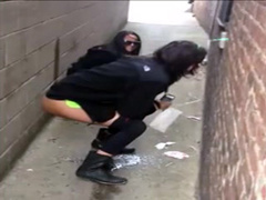 Girls caught peeing in an alley and laughing about it