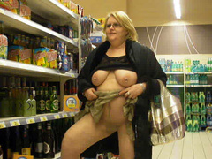 Flashing wife in the liquor store has pierced nipples