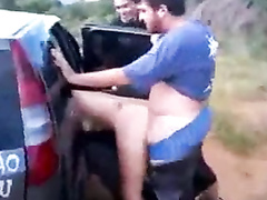 Mexican hooker bent over car seat and penetrated doggystyle