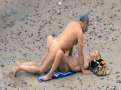 Old daddy tempts the young blonde on a beach