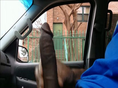 Stroking his large ebony dick in the car