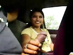 Latina amateur gives a handjob in the car
