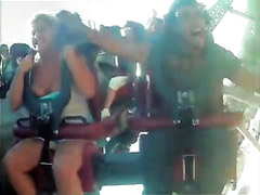 Amateur tits pop out during a roller coaster ride