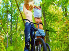 Naked young beauties ride bikes in the woods