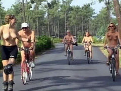 Nudist women take a bike ride to the beach