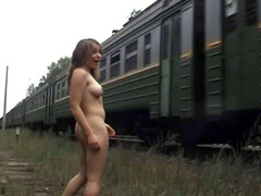 Russian brunette poses naked as train passes by
