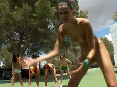 Topless and naked girls play a game of basketball