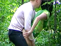 Girl in a dress fucked doggystyle in the woods