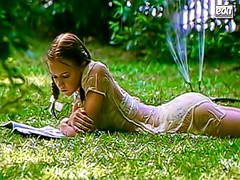 Dominique Swain in wet clothes in the grass