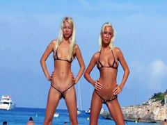 Russian blondes in string bikinis strip on public beach