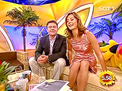 Panty upskirt of TV host in pink satin dress