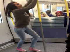 Playful college chick pisses on the subway platform