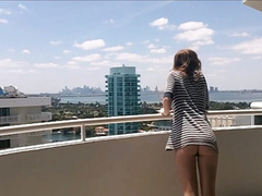 Tight young ass on the deck of the condo