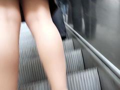 Close up escalator upskirt shows her underwear