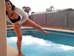 Busty chick with dark colored hair pisses in the pool