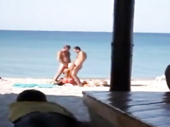 My slutty girlfriend blows two strangers at the public beach