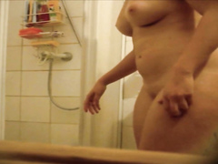 Seductive honey unveils her body before taking a shower