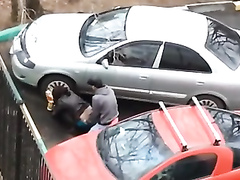 Dirty hooker gets nailed while hiding between two cars