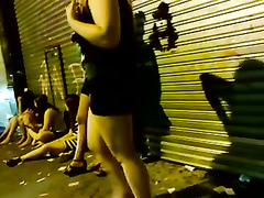Drunk bimbos walk around the town in rather revealing clothes