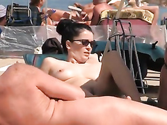 Delicious babe enjoys flaunting her steaming hot body at the nudist beach