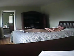 Fat cougar plays with cunny on the bed