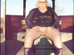 Chubby cougar soaks the concrete with pleasure